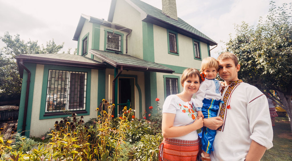 ukrainian family infront of their home