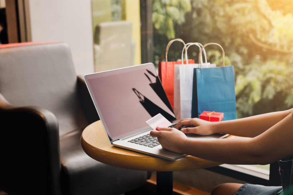 Woman using credit card to make online purchases - shopping