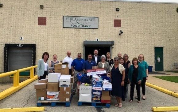 Credit Unions and Legislators Donate 1,405 Pounds of Food