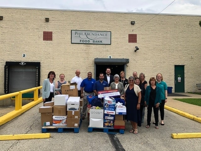 Credit Unions and Legislators Donate 1,405 Pounds of Food